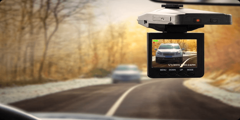 dash cam hanging from car windscreen